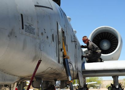 An image of an A-10 being worked on, representing the 355th Maintenance Group.